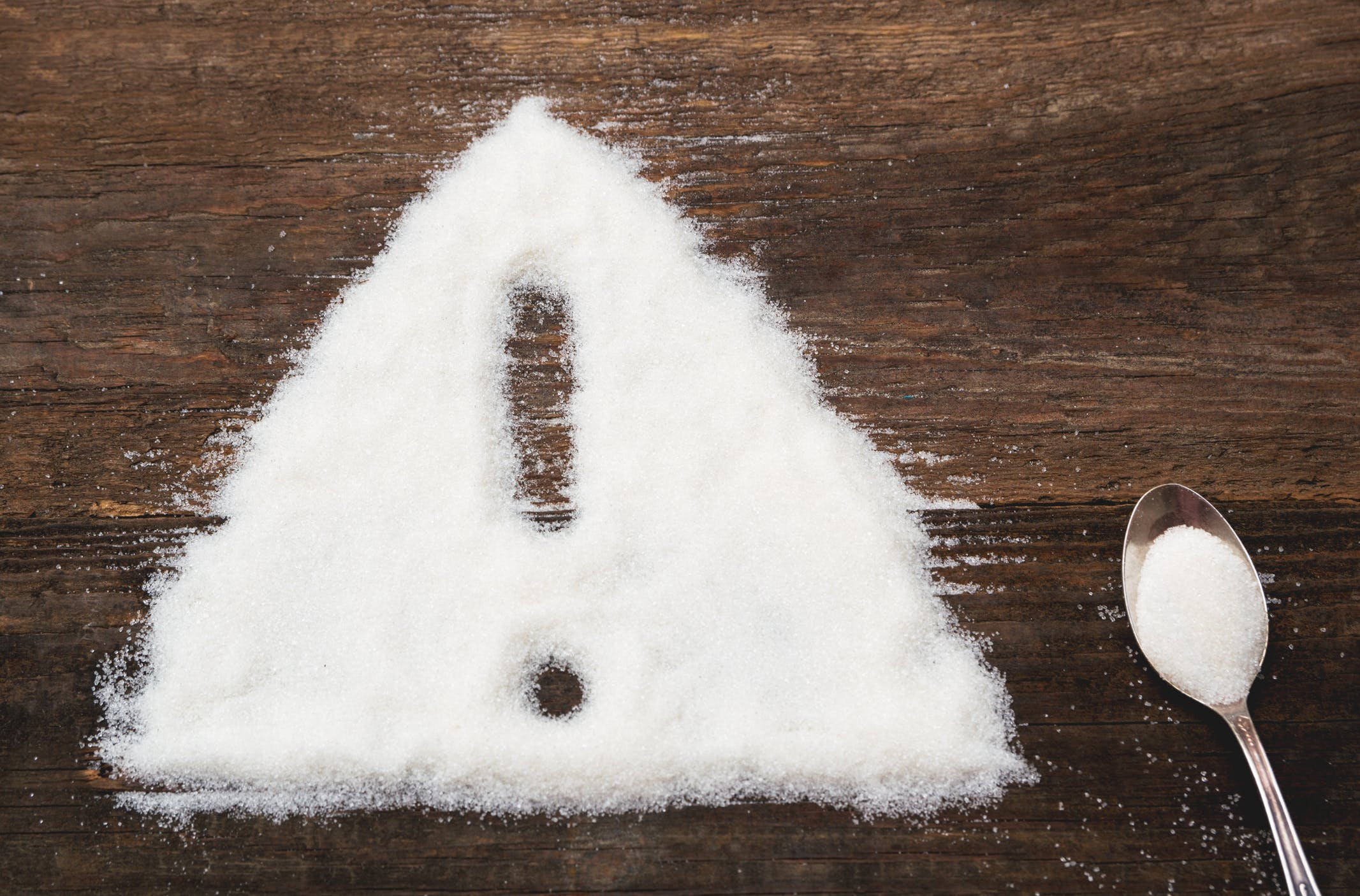 Sign of warning attention made of granulated sugar