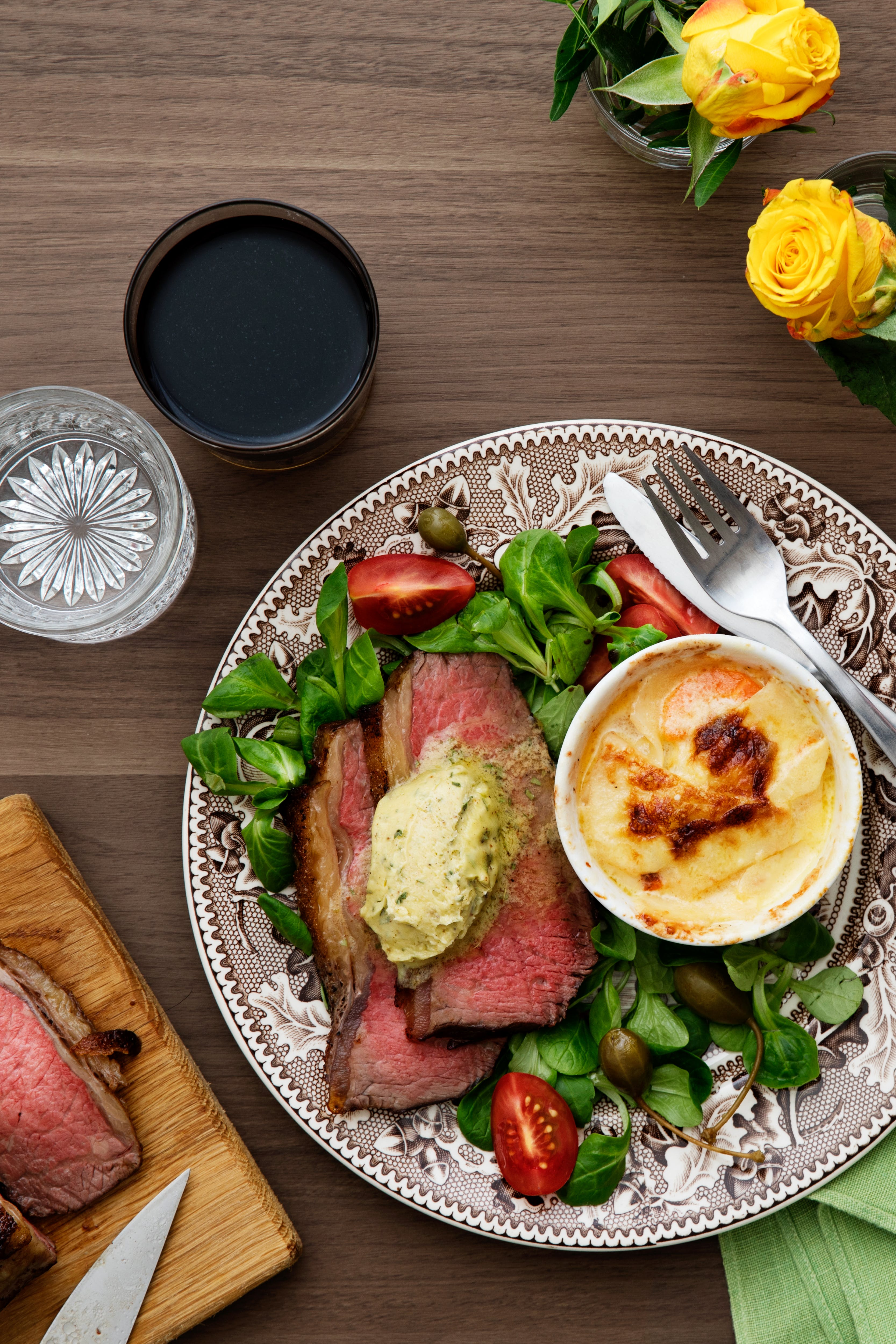 Beef sirloin with tarragon butter and creamy gratin