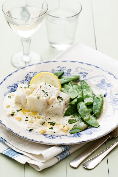 Fish with creamy egg sauce and sugar snaps