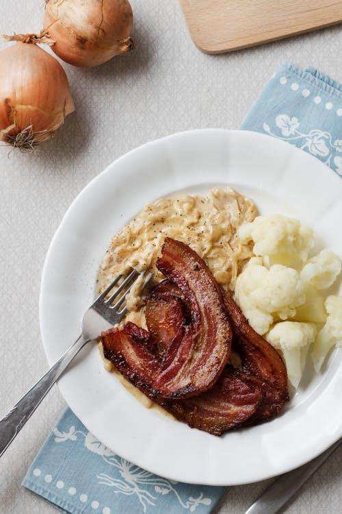 Keto crispy fried pork belly with onion sauce
