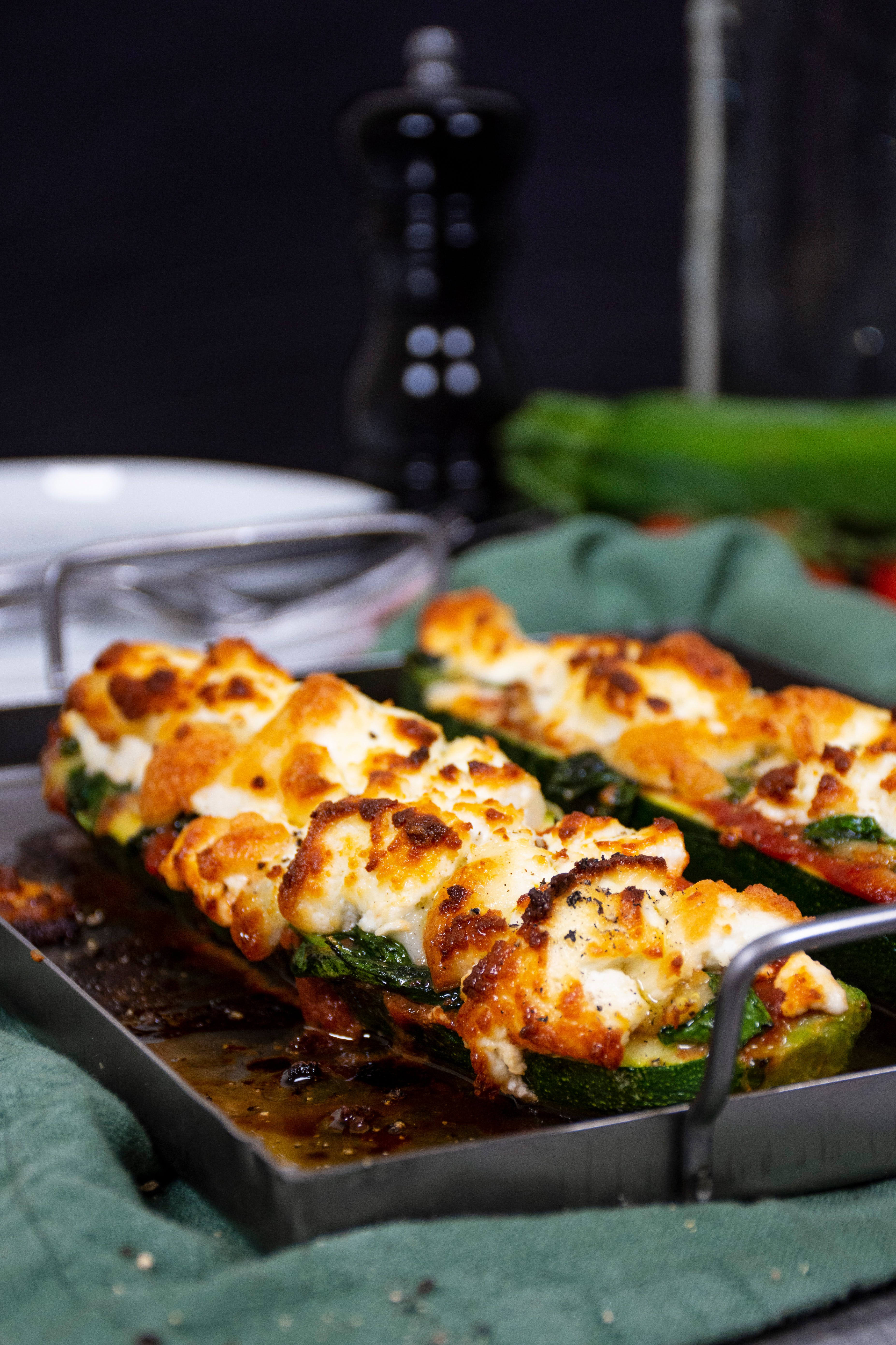 Keto zucchini pizza boats with goat cheese