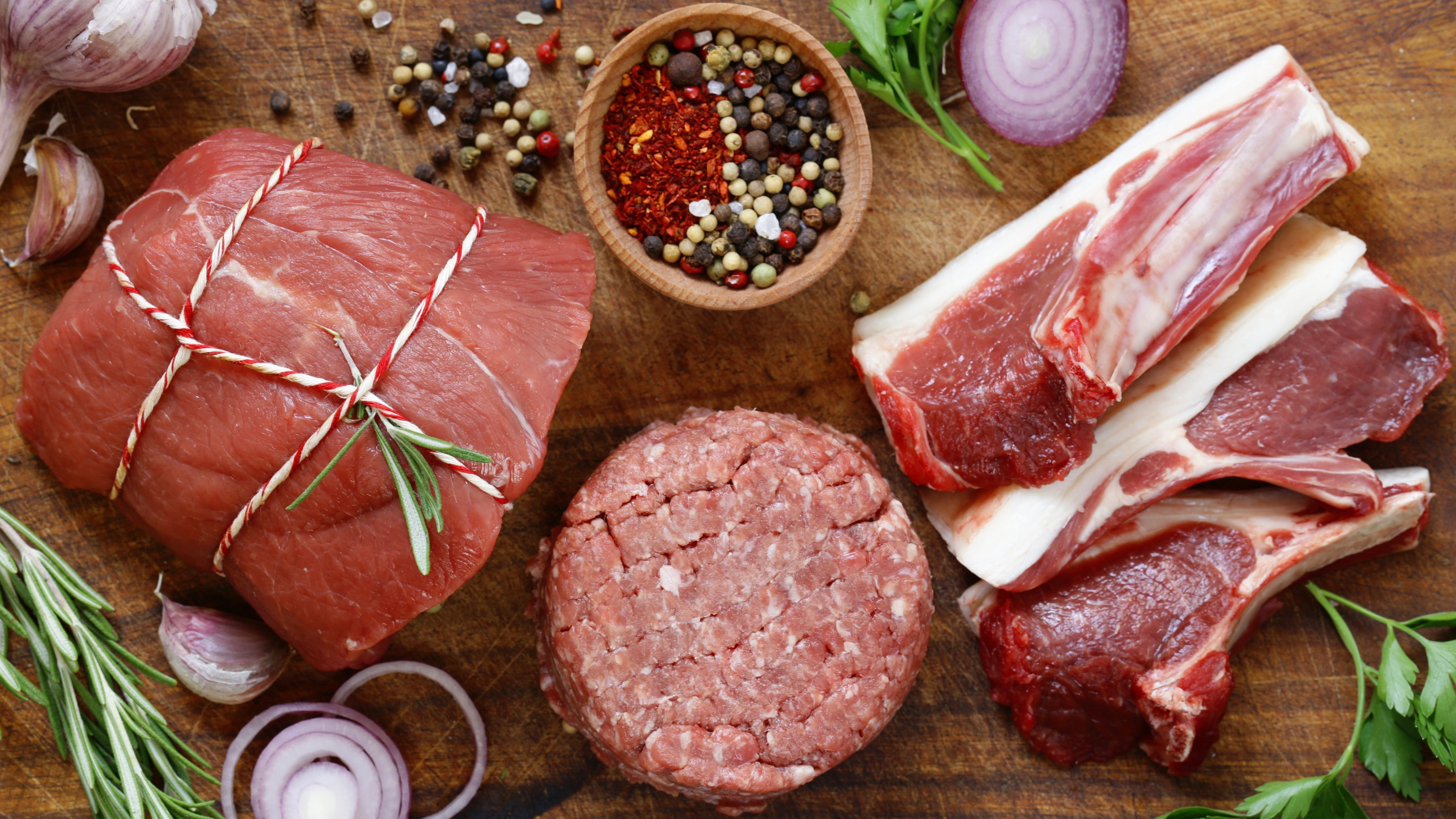 Organic raw meat on a wooden table