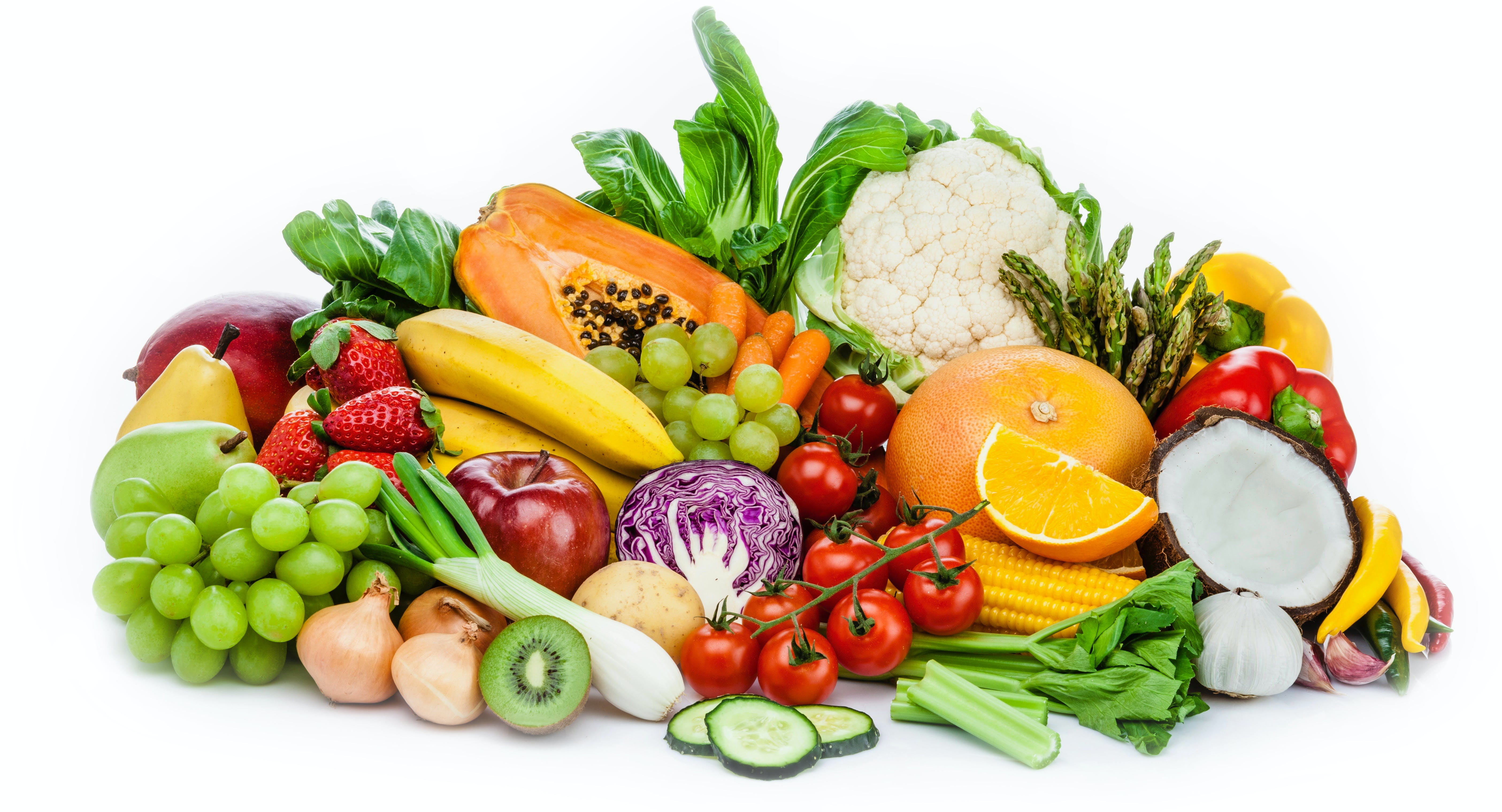 Healthy fresh fruits and vegetables heap isolated on white background