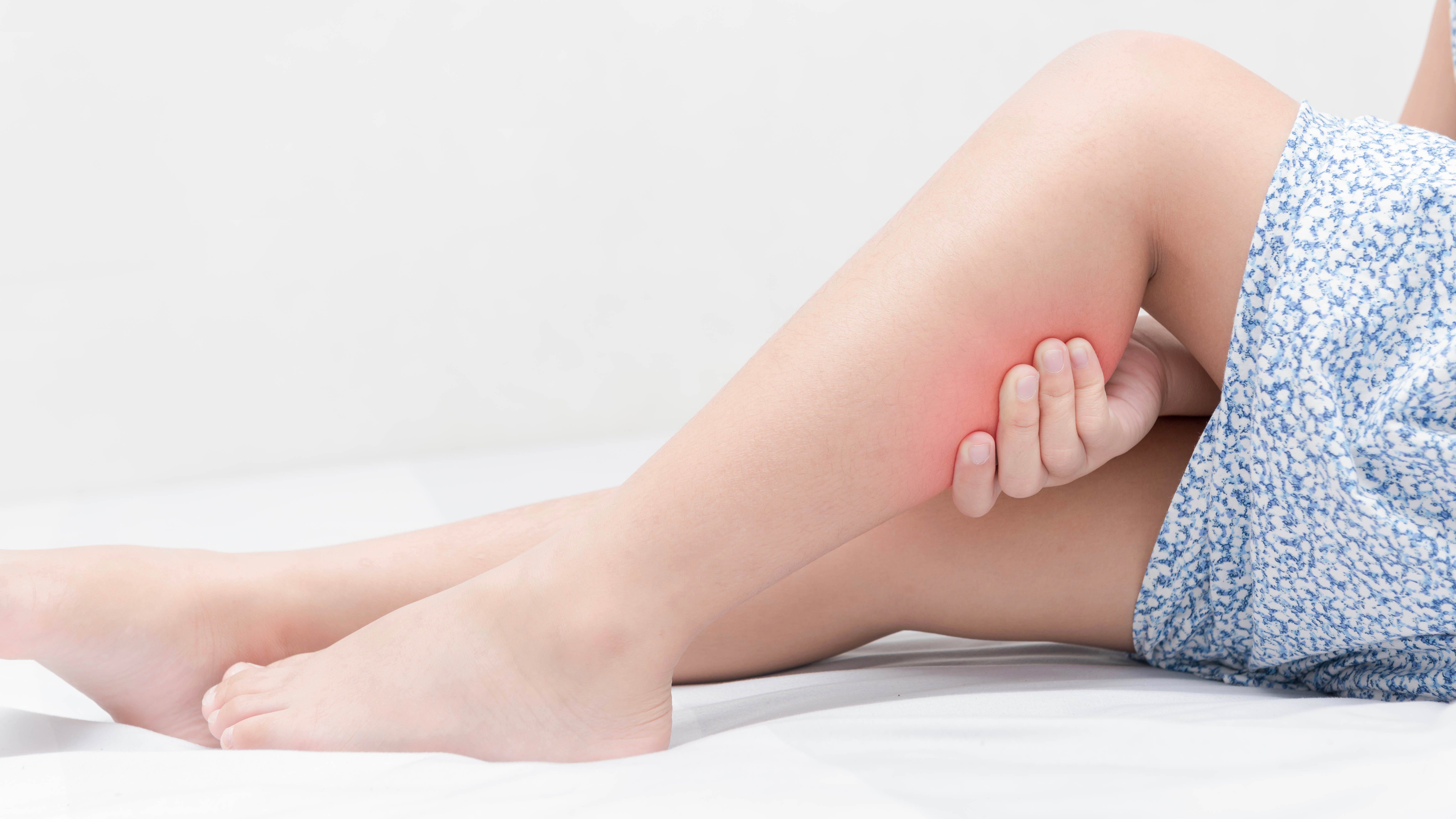 Leg pain in a girl on bed,