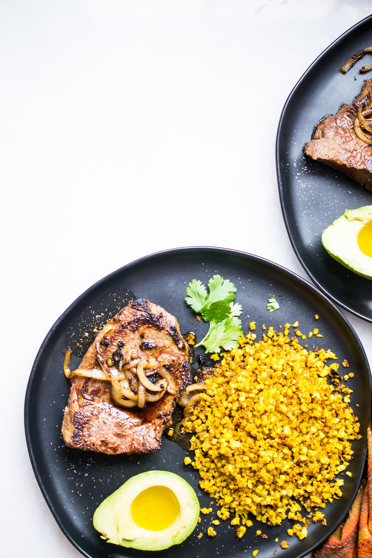Pan-seared steak with yellow rice