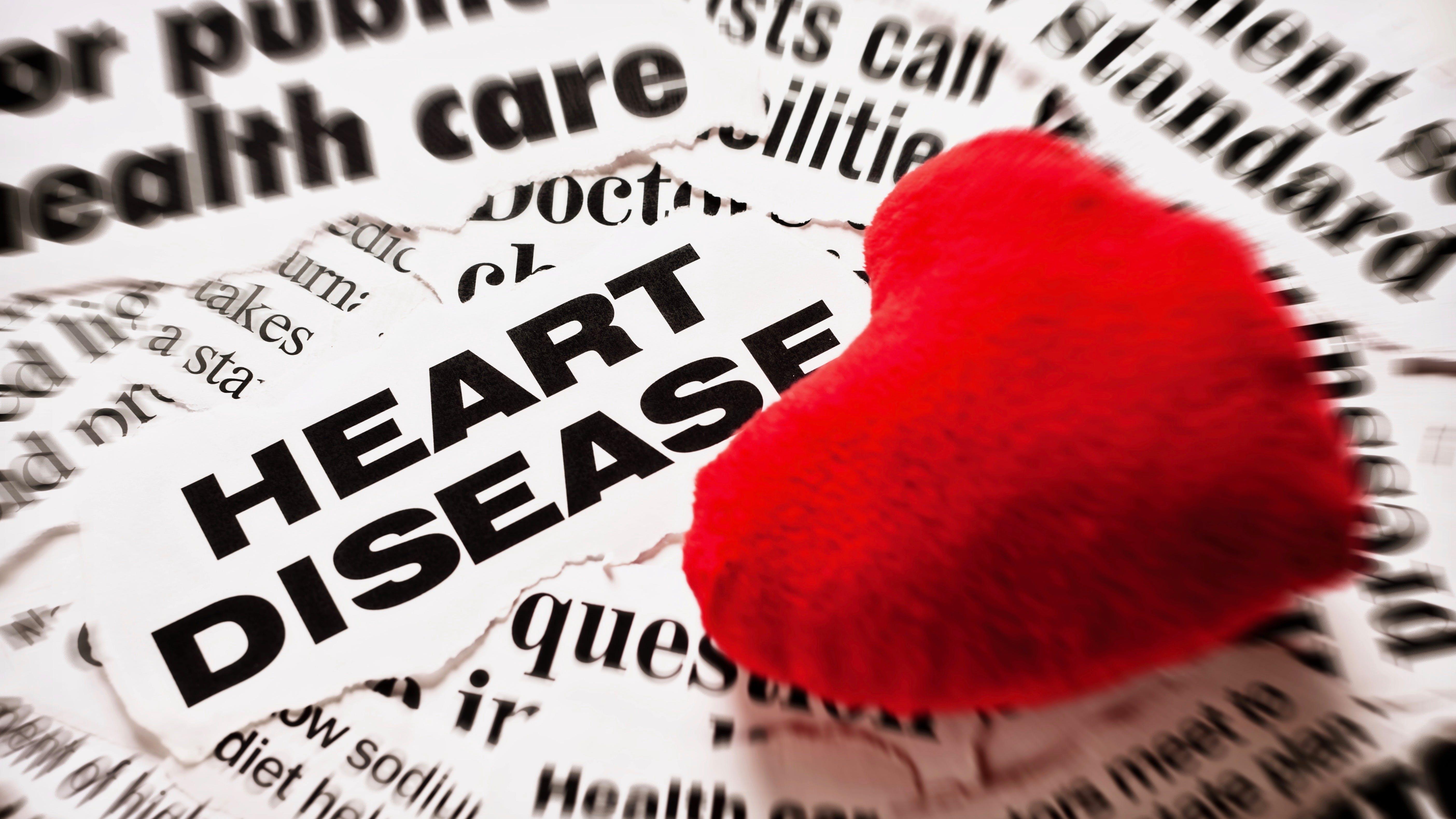 Red plush Valentine on heart disease headlines