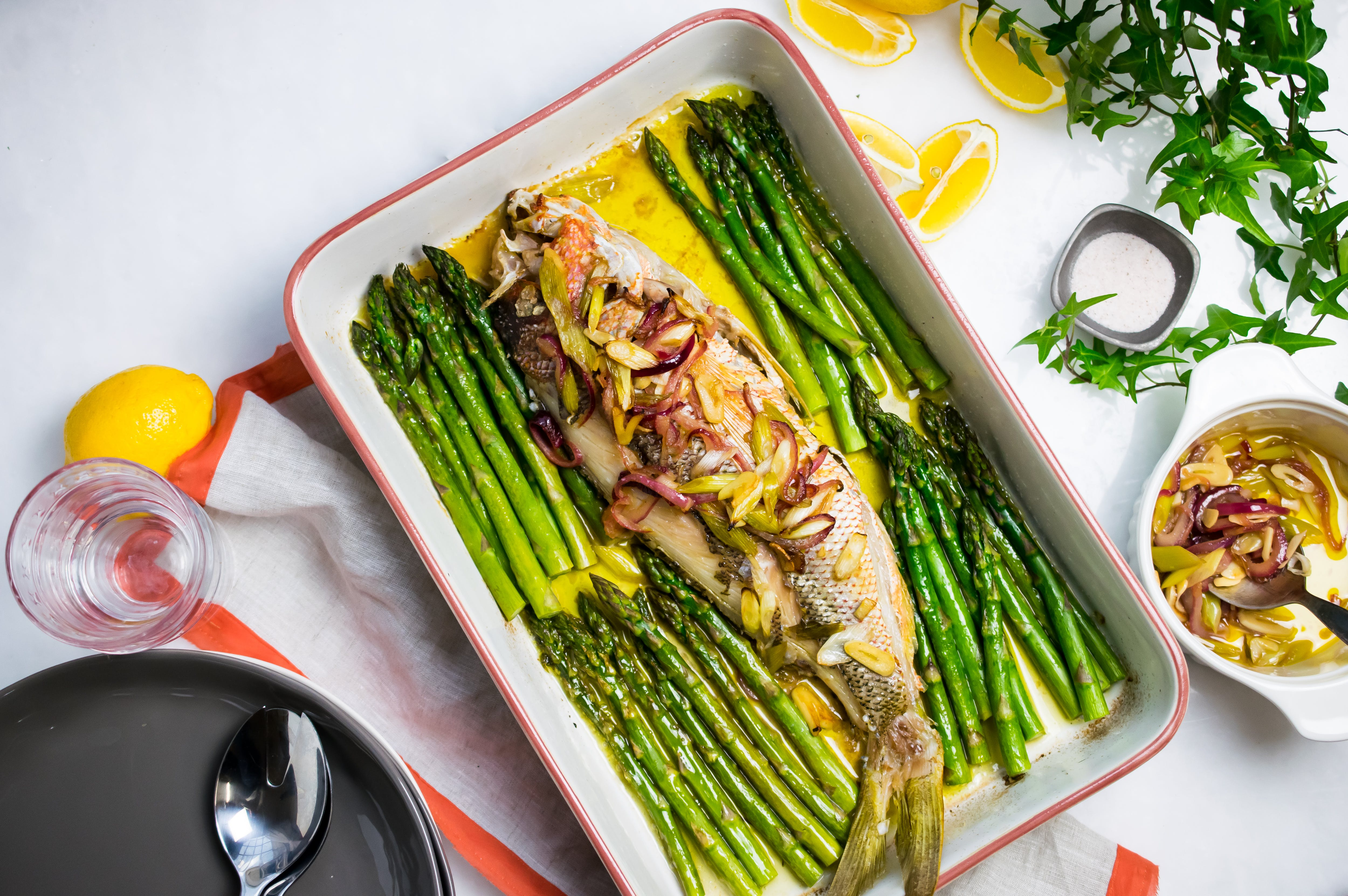 Baked snapper with onions and asparagus