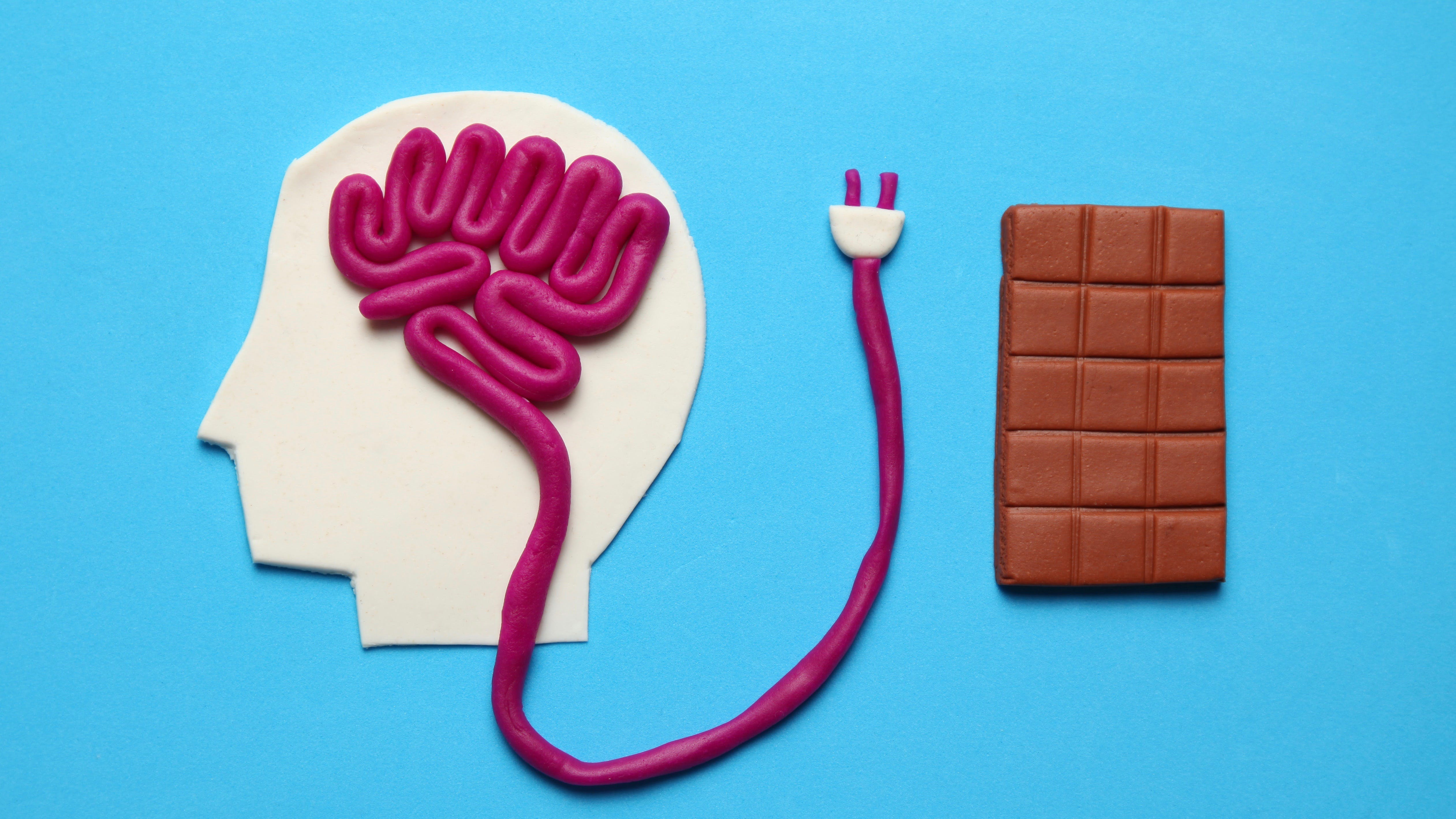 Figure of man and bar of sweet chocolate. Nutrition brain energy for mind