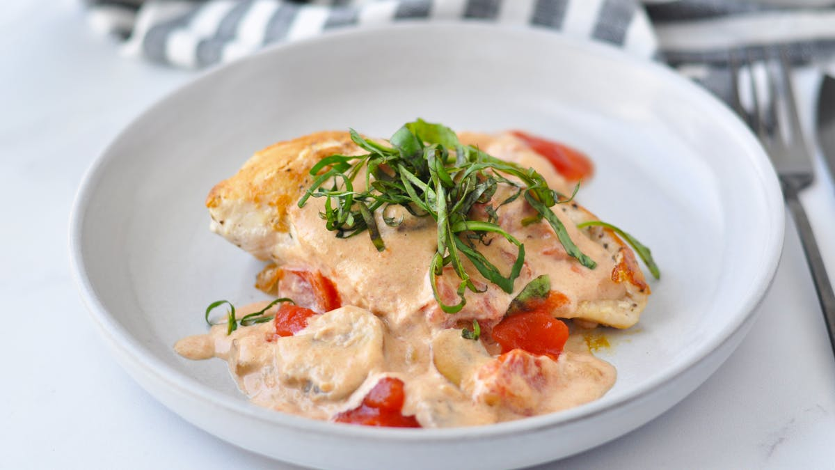 Keto chicken and mushrooms with tomato cream sauce