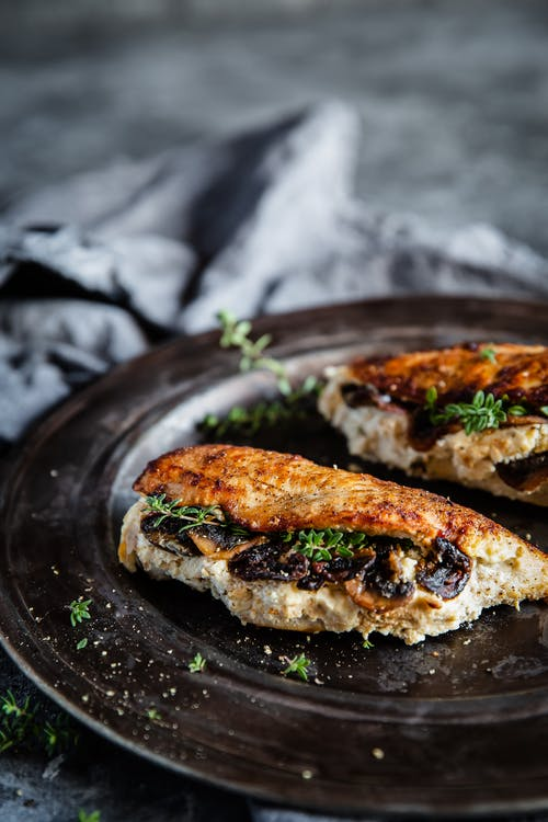 Mushroom and ricotta stuffed chicken breasts