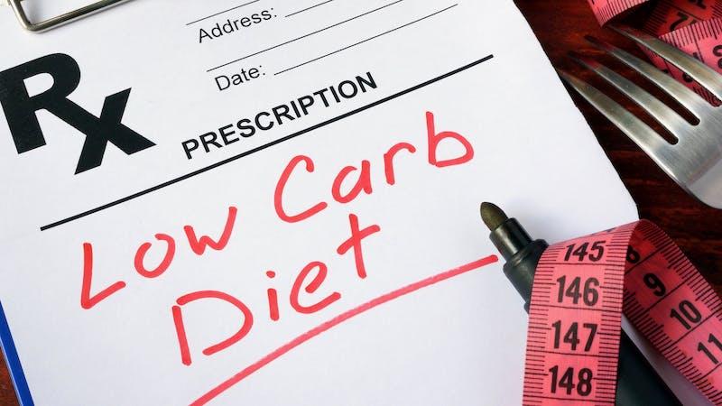Prescription form with words low carb diet.