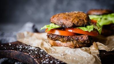 Low-carb vegan tempeh burger with portobello bun