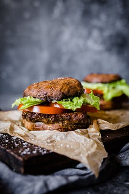 Low-carb vegan tempeh burger with portobello bun