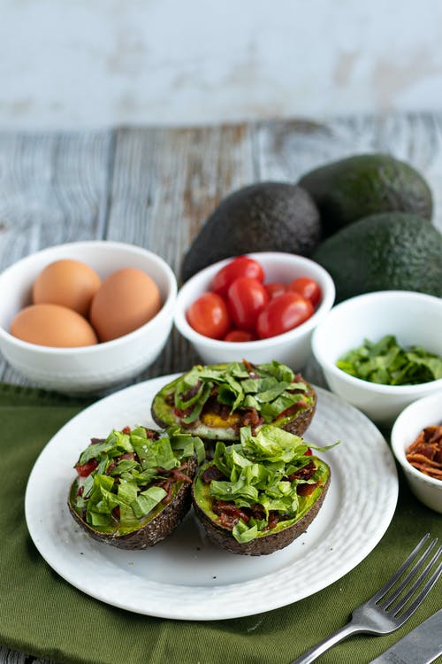Keto BLT baked avocado eggs