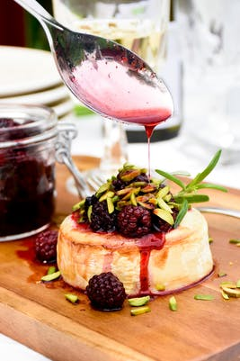 Keto baked goat cheese with blackberries and roasted pistachios