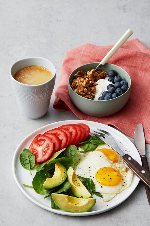 Simple liberal low-carb breakfast with fried eggs and yogurt