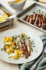 Flank steak with pepper sauce and cauliflower-broccoli gratin