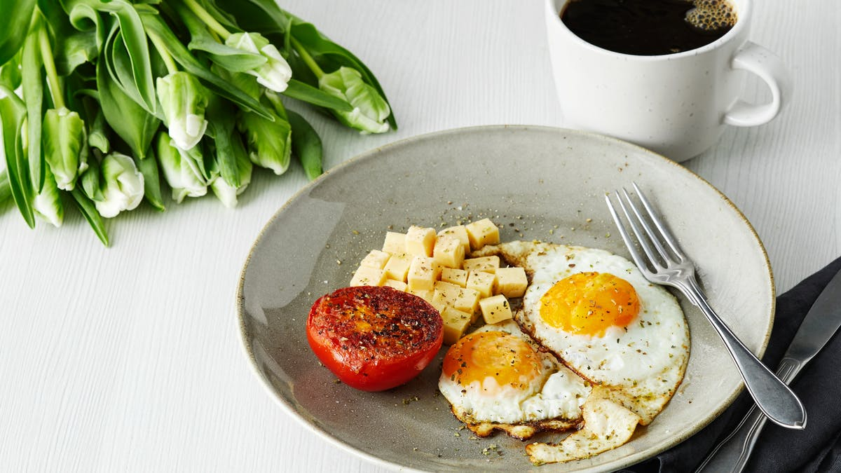 Keto breakfast with fried eggs, tomato and cheese