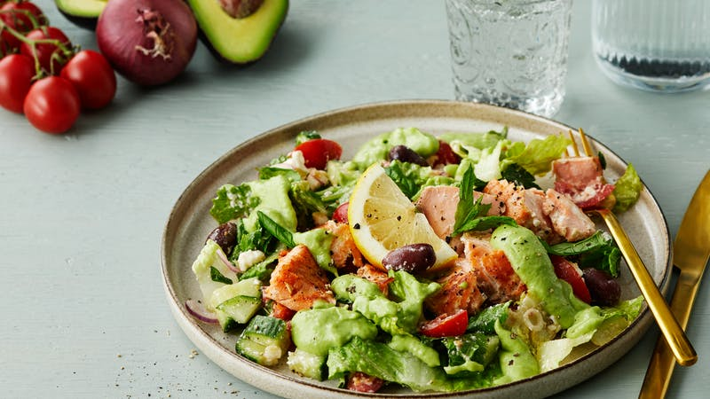 Salmon salad with feta cheese and avocado dressing
