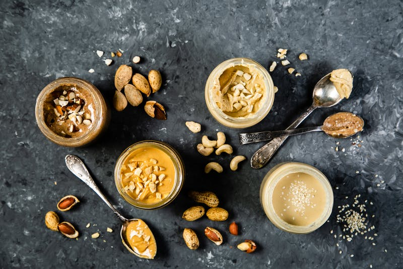 Selection of nut butters – peanut, cashew, almond and sesame seeds