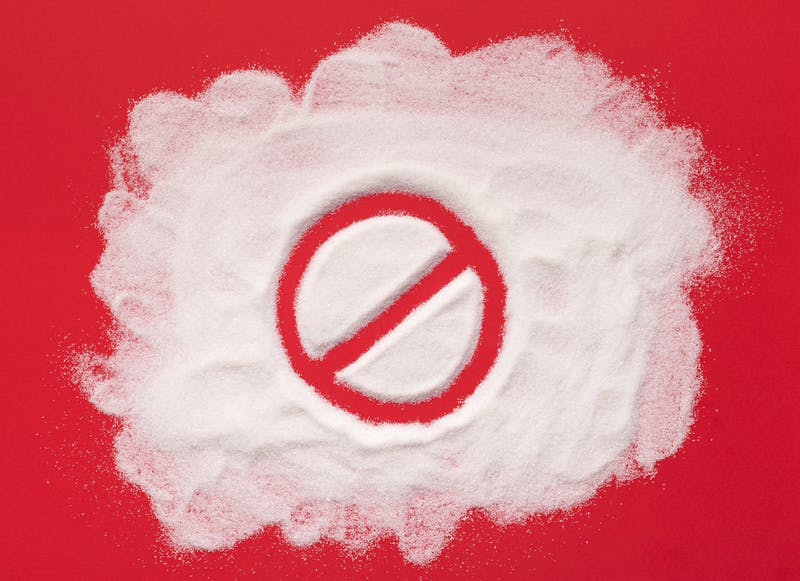 Stop prohibition sign on white sugar background