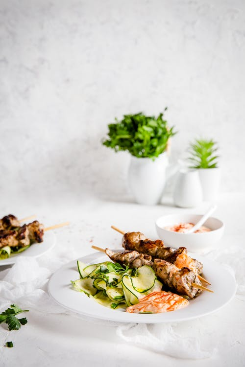 Grilled pork skewers with ribbon zoodles