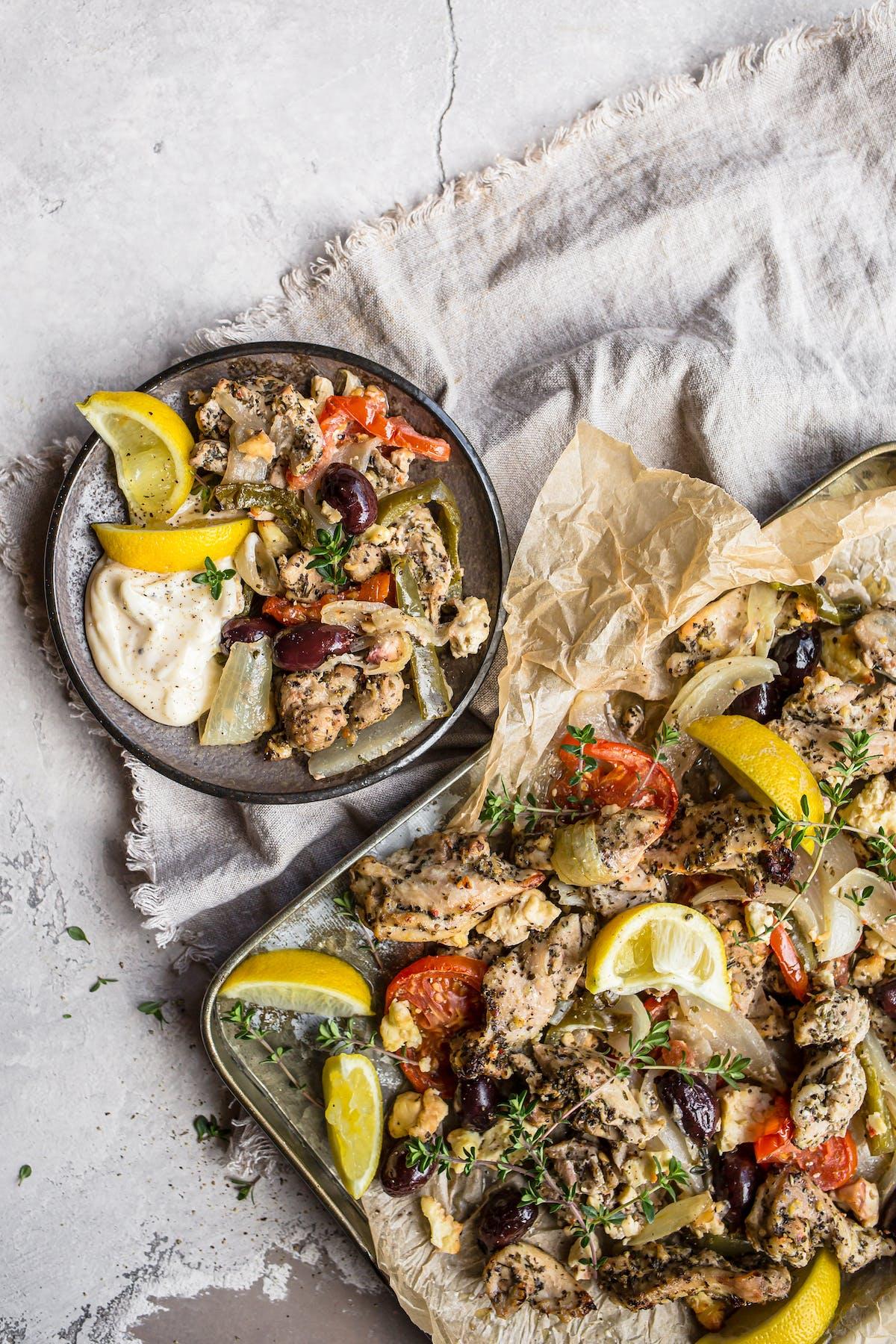 Greek chicken sheet-pan meal with garlic sauce