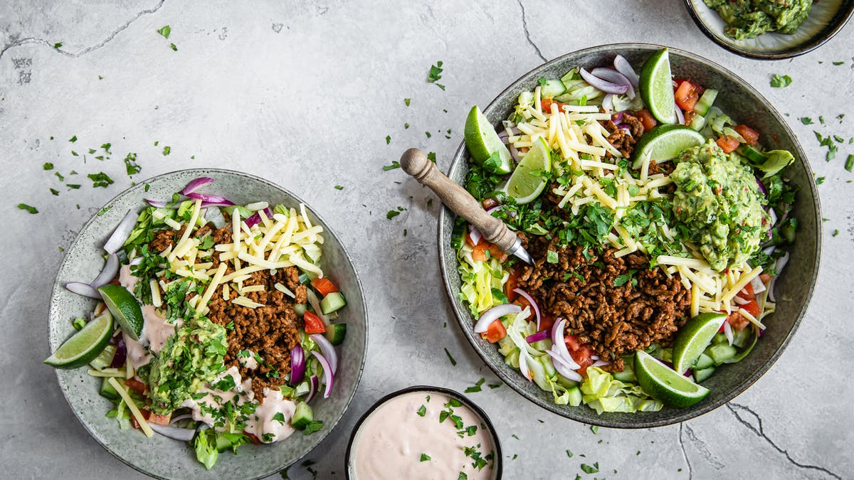 Keto taco salad with salsa dressing and guacamole