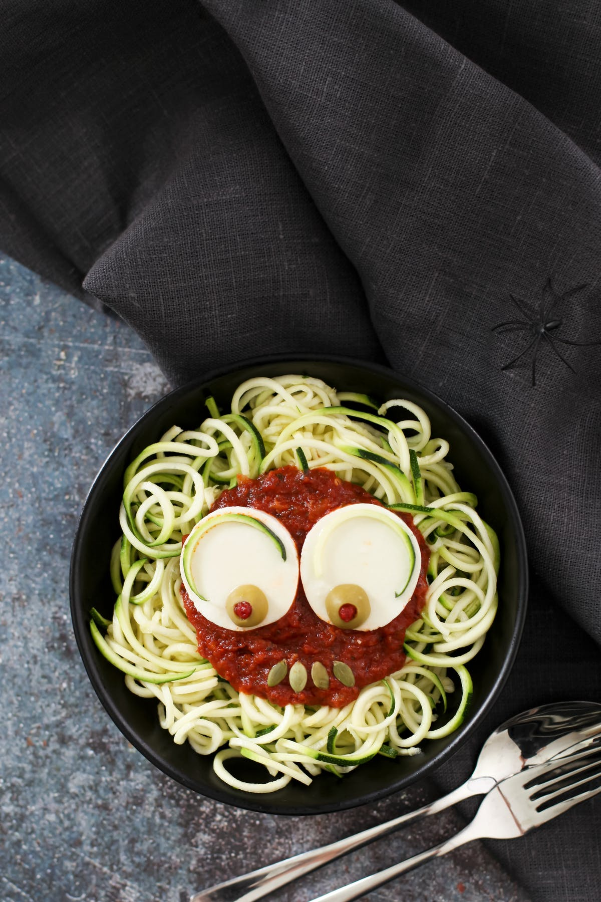 Spooky zoodles with tomato sauce and mozzarella