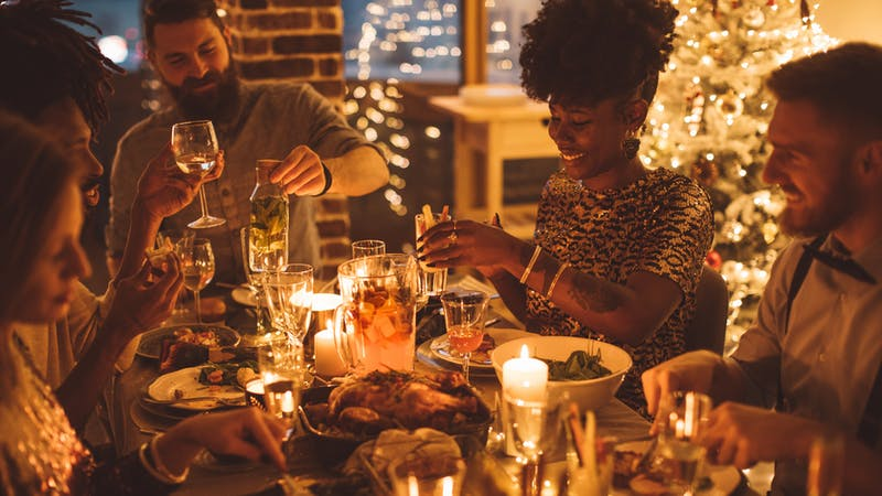 Cozy New year dinner among friends