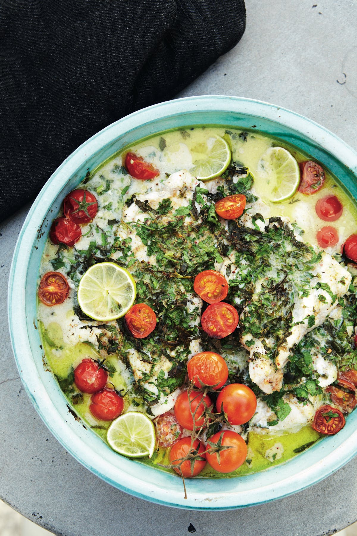 White fish with herbs, coconut milk, lime, and tomatoes