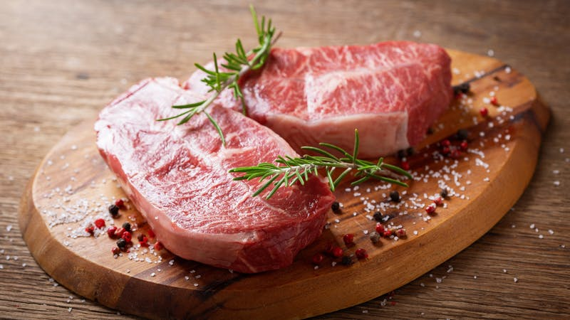 fresh meat with rosemary and spices