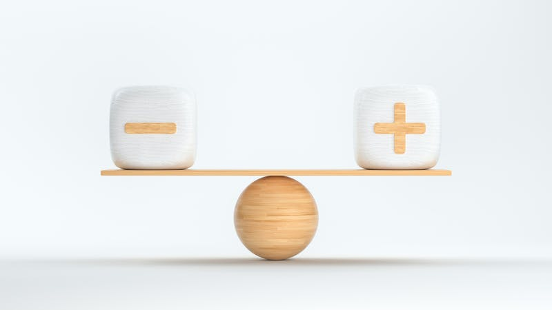 wooden scale balancing cubes with plus and minus symbols – 3D rendered illustration