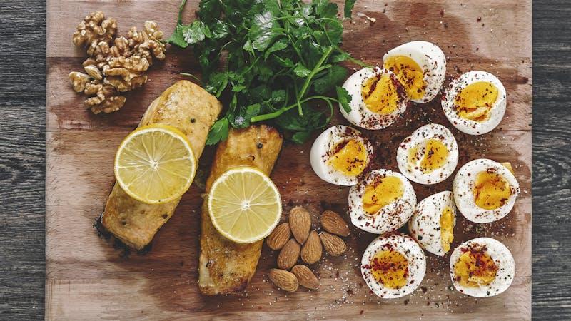 Baked salmon steak with vegetables. eggs, nuts - Diet menu, Top view
