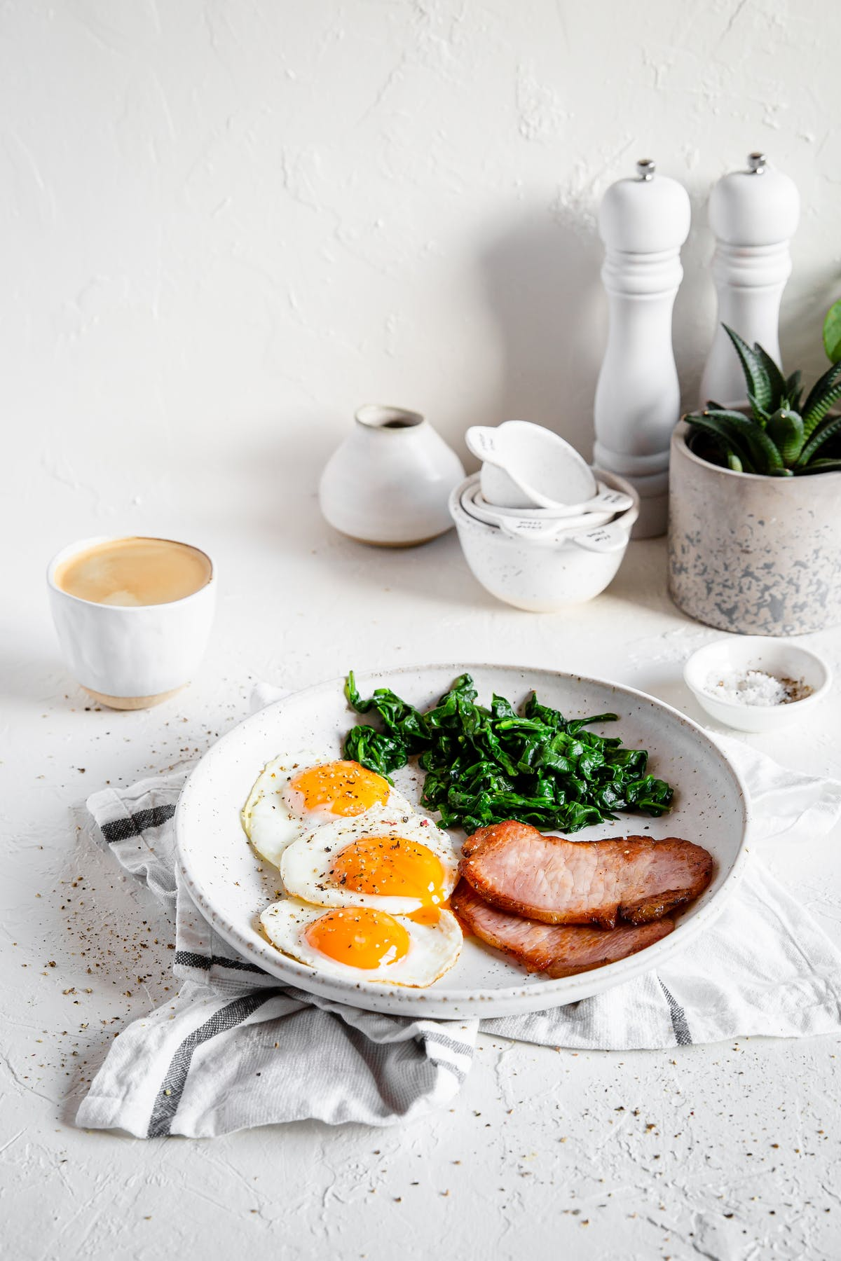High protein breakfast with Canadian bacon, eggs, and spinach