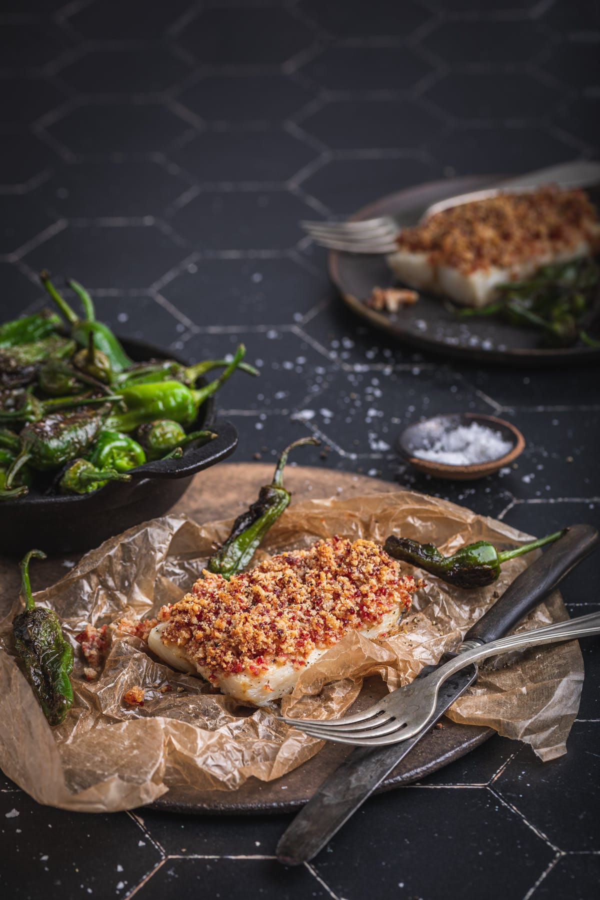 Chorizo crumb-topped cod with Padrón peppers
