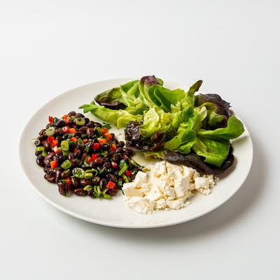female-vegetarian-plate-with-edamame-and-feta-cheese