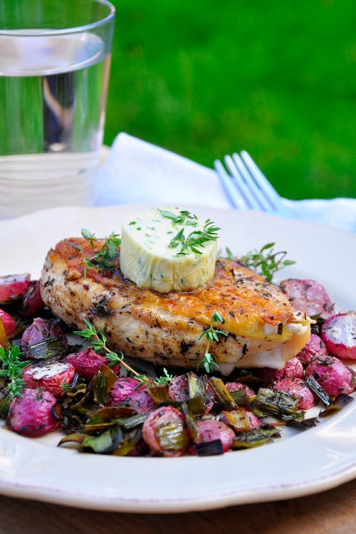 Oven baked chicken breast and radishes with thyme butter