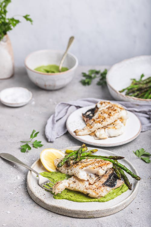 Hake fish in green sauce with asparagus