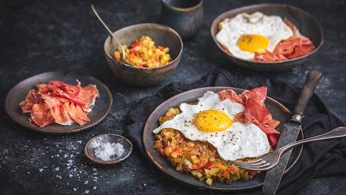 Spanish ratatouille with egg and Serrano ham