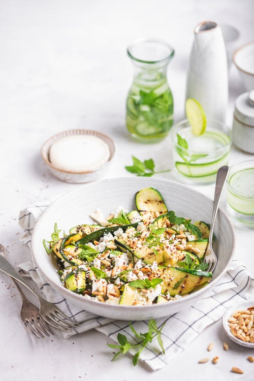 Grilled zucchini salad with goat cheese, pine nuts, and mint