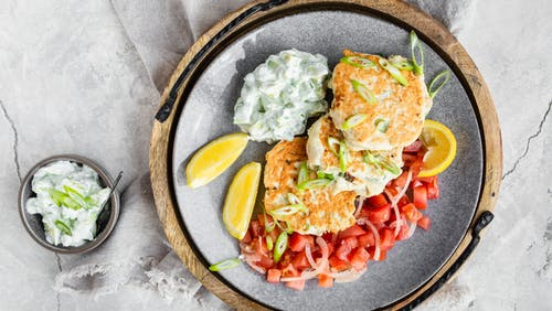Keto chicken fritters with avocado tzatziki and tomato salad
